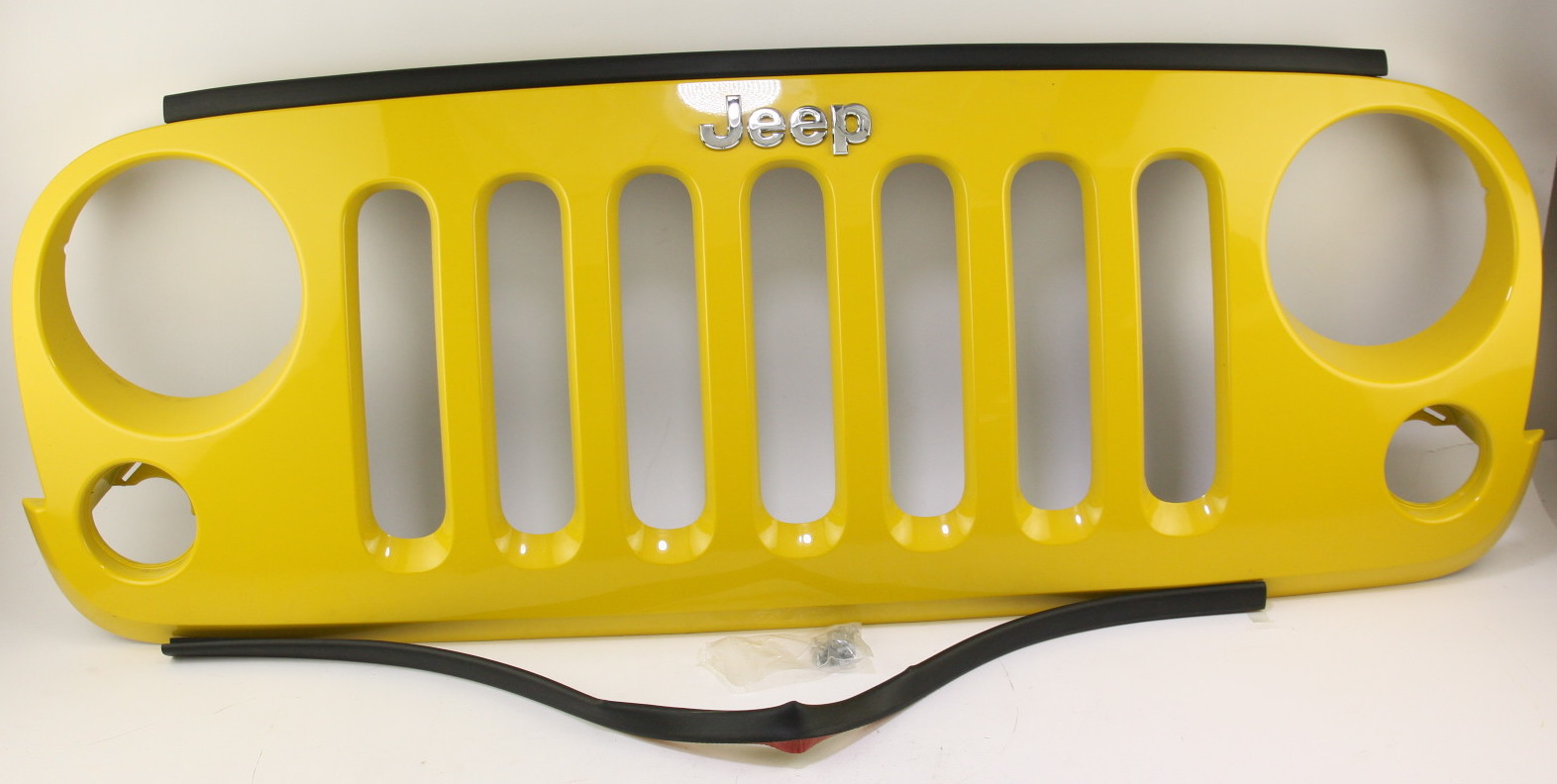 *New OEM 82210558AD Mopar 07-17 Jeep Wrangler JK Yellow Grille Free Shipping NIP - image 1