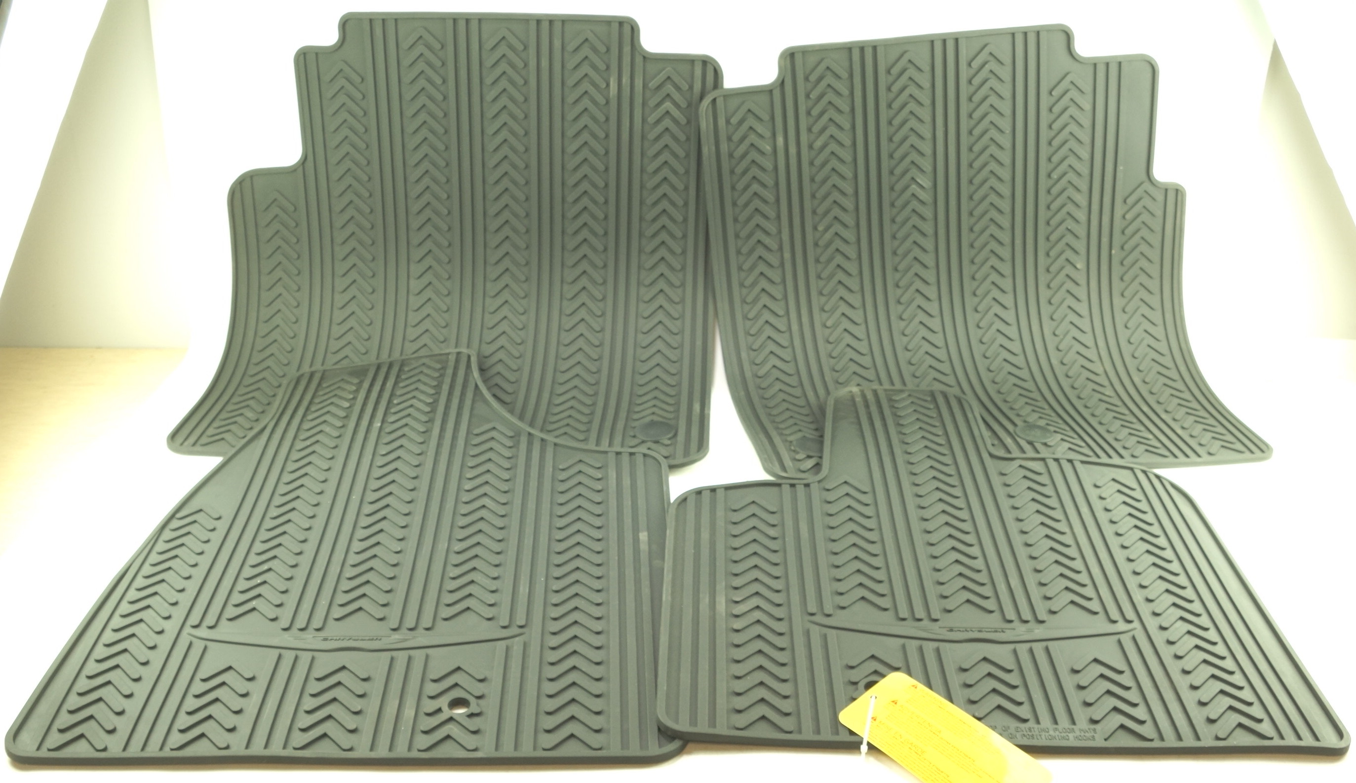 New OEM 82213479 Mopar Town & Country Front & 2nd Row Black Rubber Floor Mats - image 1
